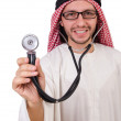 Arab doctor with stethoscope on white — Stock Photo