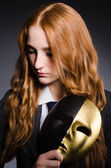 Woman with mask in hypocrisy concept — Stock Photo