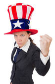 Young woman with american symbols on white — Stock Photo