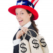 Businesswoman with sacks of money on white — Stock Photo