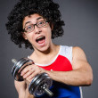 Funny man exercising with dumbbells — Stock Photo
