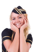 Young flight attendant isolated on the white — Stock Photo