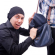 Stock Photo: Young thief stealing woman's bag