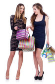 Best friends afte shopping on white — Stock Photo