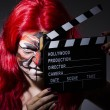 Woman with facepaint and movie clapper — Stock Photo