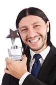 Businessman with star award isolated on white — Stock Photo