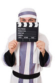 Arab man with movie clapper on white — Стоковое фото