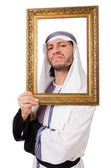 Young arab with picture frame — Stock Photo