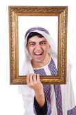 Arab with picture frame — Stock Photo