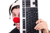 Funny clown with keyboard — Stock Photo