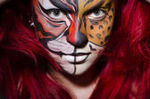 Woman with face painting — Stock fotografie