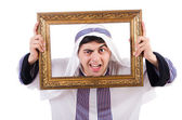 Arab with picture frame on white — Stock Photo