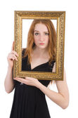 Woman with picture frame — Stock Photo