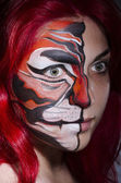 Woman with face painting — Stock Photo