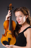 Woman artist with violin — Stockfoto