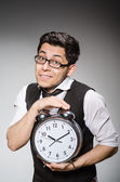 Businessman with clock — Stock Photo