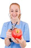 Красивая доктор в синей форме — Стоковое фото