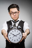 Businessman with clock — Stock Photo