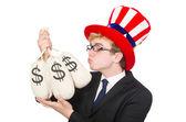 Man with dollar sacks — Stock Photo