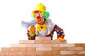 Clown laying bricks — Stock Photo