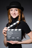 Girl in hat with movie board — Stock Photo