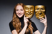 Woman with masks in hypocrisy consept — Stock Photo
