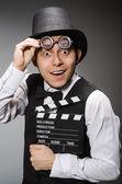 Hombre con chapaleta de película — Foto de Stock