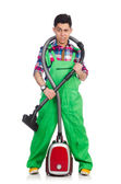 Man coveralls vacuum cleaning — Stock Photo