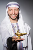 Arab with lamp — Stock Photo