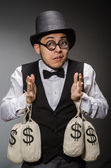 Man with sacks of money — Stock Photo