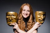 Redhead woman with masks — Stockfoto