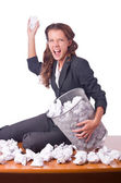 Woman with lots of discarded paper — Stock Photo