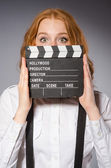 Young woman with movie board — Stock Photo