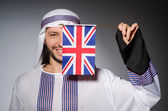 Arab man with united kingdom flag — Stock Photo