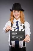 Mujer joven con tablero de película — Foto de Stock