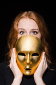 Woman iwith masks in hypocrisy consept — Stock Photo