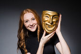 Woman with mask in hypocrisy consept — Stock Photo