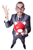Grappige mens met spaarpot — Stockfoto