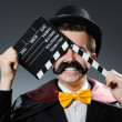 Man with movie clapper board — Stock Photo #48597281