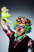 Clown with watering can — Stock Photo