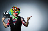 Clown with  movie board — Stock Photo