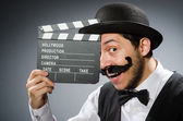 Man with movie clapper board — Stock Photo