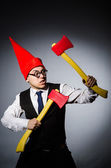 Man with axes in funny concept — Stock Photo