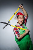 Funny man with giant shears — Stock Photo