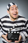 Inmate with  movie clapper — Stock Photo