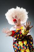 Funny clown in the studio — Stock Photo