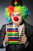 Clown geschäftsmann mit abakus — Stockfoto
