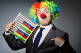 Funny clown businessman with abacus — Stock fotografie