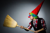 Funny clown with the broom — Stock Photo