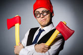 Man with axes in funny concept — Stockfoto